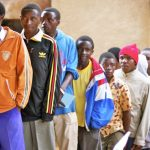 African men entering circumcision clinic